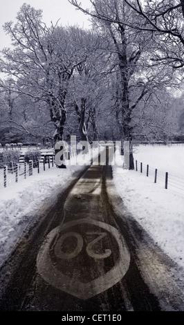 Twenty Speed Limit Sign Lamington Scotland in the Snow Winter - Stock Image