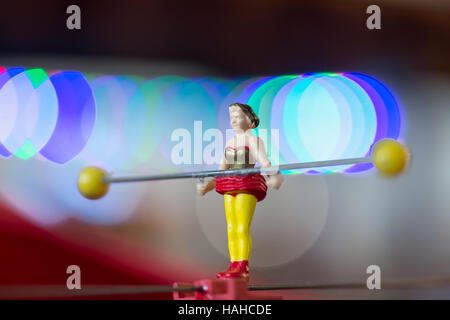 Tiny woman tightrope walker, a model figure two inches tall, in circus scene display at TMB Model Train Club, Long - Stock Image