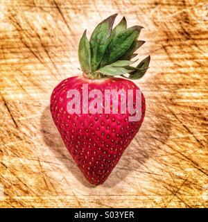 Strawberry on a cutting board - Stock Image