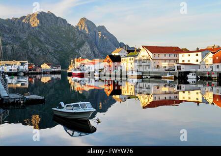 The fishing village Henningsvær on Lofoten in northern Norway at sunset. - Stock Image