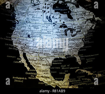 Close up view of silver on black background world globe map showing North America i.e. US aka USA aka United States aka United States of America , Canada and Mexico - Stock Image