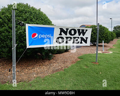 Now Open outdoor banner sign announcing a new business opening in Pike Road Alabama, USA. - Stock Image