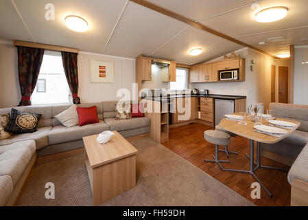 Interior of a static caravan showing living room kitchen and dining areas - Stock Image