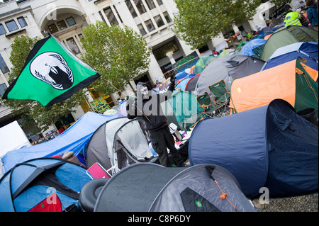 Occupy the Stock Exchange protest outside St.Pauls Cathedral, London. Some protestors have adopted the V for Vendetta - Stock Image