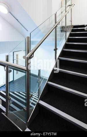 Modern staircase witt stainless steel hand rails. - Stock Image