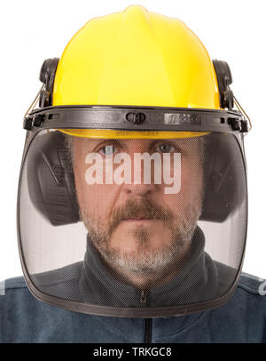 Man wearing safety helmet with font mesh and ear defenders - Stock Image