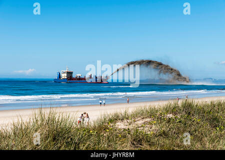 The city or Gold Coast Queensland Australia embarks upon Beach reclamation using a Netherlands dredge for the work - Stock Image