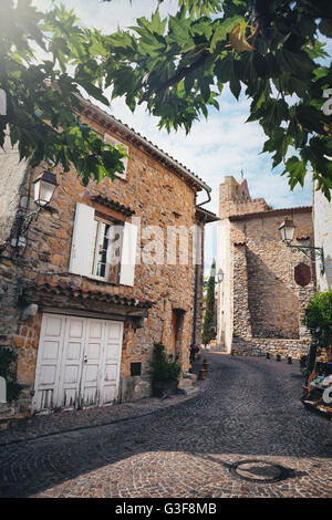 Little street with church and old house in a typical village called Le Castellet in the south of France - Stock Image