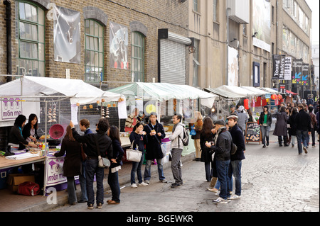 Ethnic food street vendors at UpMarket in the Old Trueman Brewery. London. Britain. UK - Stock Image