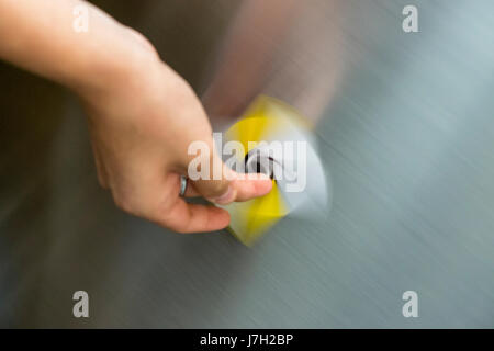 Card being spun on the side of an escalator - Stock Image