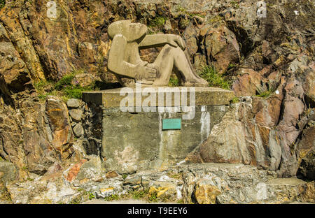 Stone Carving at Abergwaun on the Pembrokeshire Coast West Wales - Stock Image