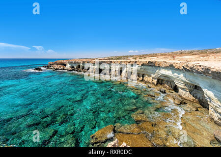 View of cliff with sea caves on Cape Greco near Ayia Napa, Cyprus - Stock Image