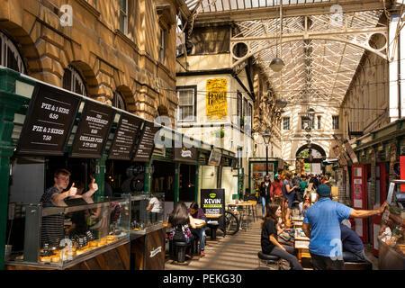 UK, England, Bristol, St Nicholas Market, Glass Arcade, cafes and restaurants - Stock Image