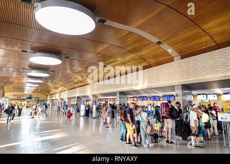 Cartagena Colombia Aeropuerto Internacional Rafael Nunez Airport inside concourse terminal Hispanic airline ticket counter lines queues passengers - Stock Image