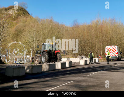 Stoney Wood, Wirksworth, Derbyshire Dales, UK. 4th March, 2019. Workmen at the local beauty spot Stoney Wood carpark as Derbyshire Dales District Council try relocating a Gypsy Roma Travellers camp on land adjacent to Stoney Wood.Wirksworth Town Council are seeking legal advise to try & protect the trees, rare wild orchids & other wildlife in and around this Sight of Special scientific Interest. Credit: Doug Blane/Alamy Live News - Stock Image