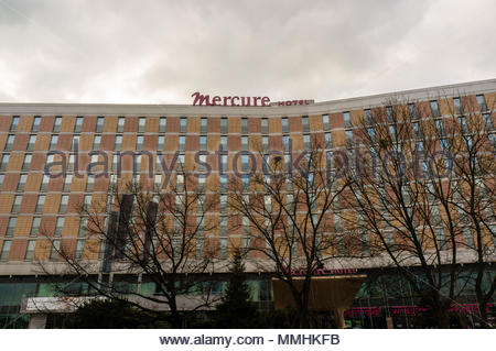 Mercure Hotel building with leafless trees on the Roosevelta street in Poznan, Poland - Stock Image