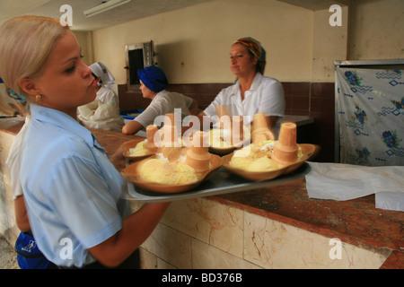 Cuba Holguin Waitress serving cream at Cremeria Guama Photo CUBA1246 Copyright Christopher P Baker - Stock Image