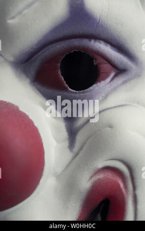 Close-up of a mask of a clown's face - Stock Image