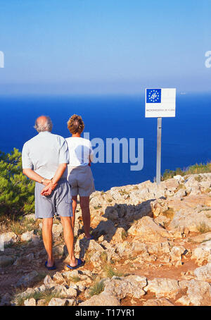 Two senior tourists at San Antonio Cape. Javea, Alicante province, Spain. - Stock Image