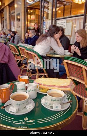 Paris St German Cafe de Flore table with cafe creme and sandwich - Stock Image