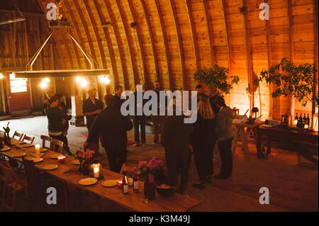inside a barn, party - Stock Image
