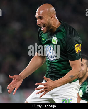 22 April 2019, Lower Saxony, Wolfsburg: Soccer: Bundesliga, 30th matchday: VfL Wolfsburg - Eintracht Frankfurt in the Volkswagen Arena. Wolfsburg's John Anthony Brooks cheers his goal to 1:1 against Eintracht Frankfurt. Photo: Peter Steffen/dpa - IMPORTANT NOTE: In accordance with the requirements of the DFL Deutsche Fußball Liga or the DFB Deutscher Fußball-Bund, it is prohibited to use or have used photographs taken in the stadium and/or the match in the form of sequence images and/or video-like photo sequences. - Stock Image
