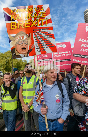 London, UK. 20th October 2018.  A man holds a placard 'Forward to a Kakikaze Brexit!'. People gather with placards, banners and flags at Hyde Park Corner for the People's Vote March calling for a vote to give the final say on the Brexit deal or failure to get a deal. They say the new evidence which has come out since the referendum makes it essential to get a new mandate from the people to leave the EU. Peter Marshall/Alamy Live News - Stock Image
