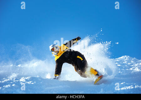 Snowboarder ski powder slope speed - Stock Image