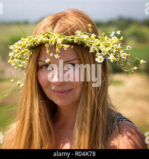 Lady with flower - Stock Image