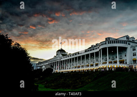 The historic Grand Hotel, built in 1887 and featuring the world's longest porch, captured at sunset, on Mackinac Island, Michigan, USA. - Stock Image