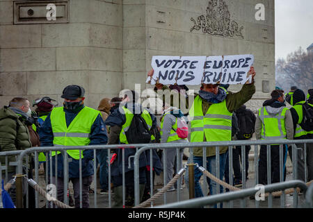 Paris, France. 1st December, 2018.  'Europe ruins' on a sign at Arc de Triomphe during the Yellow Vests protest against Macron politic. Credit: Guillaume Louyot/Alamy Live News - Stock Image