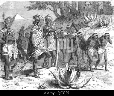 Aztec Warriors directing a caravan of porters on a Mexican Mountain Highway. - Stock Image