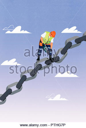 Construction worker breaking a link in chain with pneumatic drill - Stock Image