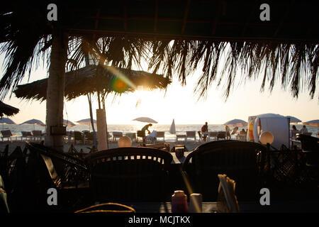 Bamboo hut on beach on sea in Goa India - Stock Image