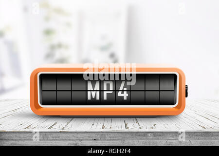 Mp4 sign on a analog device in a bright living room on a wooden desk - Stock Image