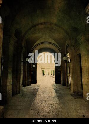 Arcade view of entrance to the galleries of the Place du Palais-Royal in the historic centre of Paris, France. Antique, - Stock Image