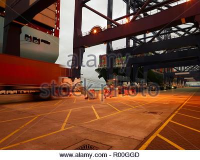 Long exposure of trucks driving at Port of Felixstowe, England - Stock Image
