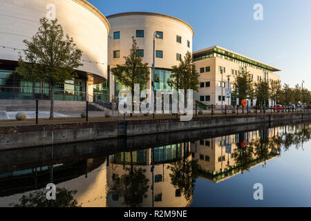 Civic Centre reflected in canal  at Lagan Valley Island, Lisburn, County Antrim, N.Ireland. - Stock Image