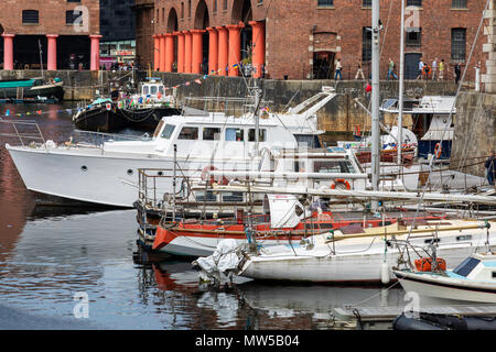 Numerous small boats berthed in the Albert Dock Liverpool visiting the Tall Ships Festival May 2018 - Stock Image