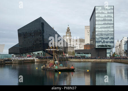 A raft floats in Canning Dock as part of the 2018 Giant Spectacular event in Liverpool city centre UK - Stock Image