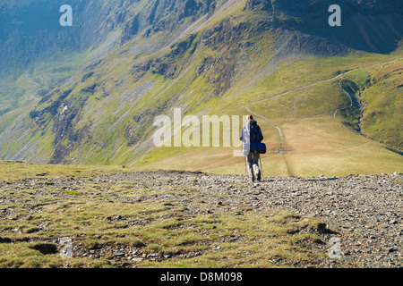 A hiker Walking down from Sand Hill to Coledale Hause in the Lake District - Stock Image