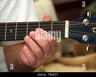 Close up of man playing guitar - Stock Image