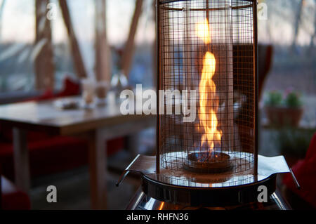 Gas flame heater typically used on outdoor patios and restaurants. - Stock Image