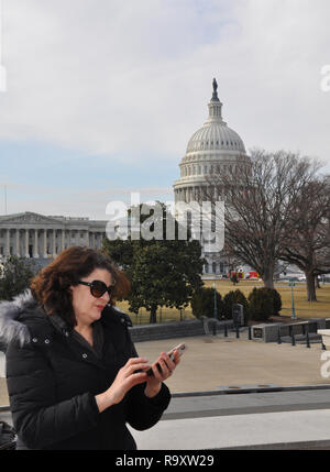Woman messaging with View of US Capitol, Washington DC - Stock Image