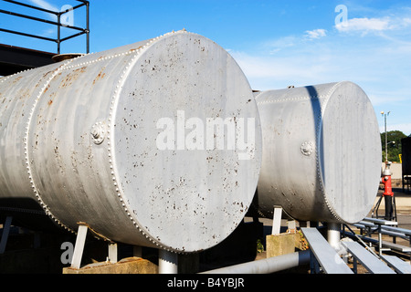 OIL TANKS, FUEL, ENERGY, EXPENSIVE, STORAGE TANKS, STORAGE, ECONOMY, RAW, COMMODITY, OIL, FENCE, SECURITY, BARBED - Stock Image