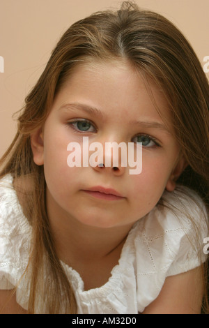 Portrait of young girl with serious expression - Stock Image