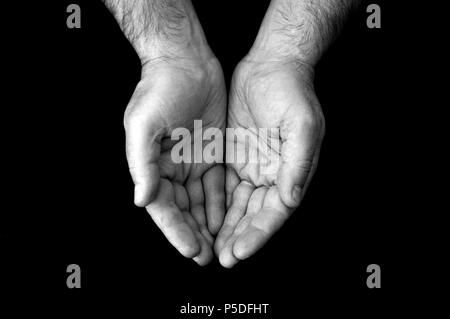 A black and white shot of a cupping pair of hands. - Stock Image