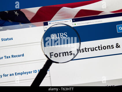 MONTREAL, CANADA - APRIL 24, 2019 : IRS Forms and Instructions USA Government home page under magnifying glass. IRS.com is an official web site of Int - Stock Image