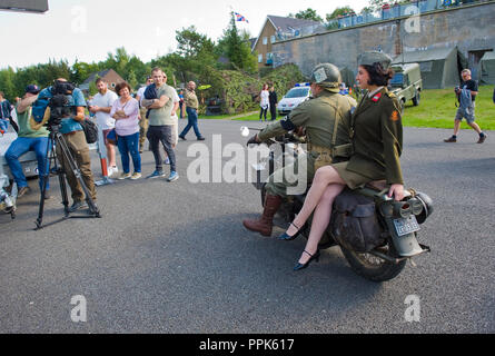 ENSCHEDE, THE NETHERLANDS - 01 SEPT, 2018: A motorcycle with on the back a singer from 'Sgt. Wilson's army show' during a military army show. - Stock Image