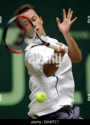 German tennis pro Philipp Kohlschreiber smashes a forehand in his quarter-finals match against seeded US James Blake - Stock Image